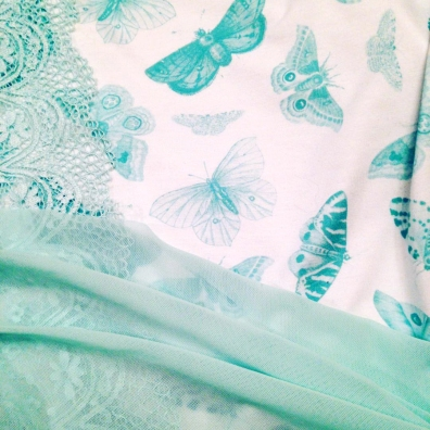 Seafoam butterfly fabric design and hand dyed lingerie lace and mesh to match by blue hours atelier. Click through for more examples of custom fabric design, lingerie work, and where to shop designs.