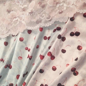 Pink and seafoam cherry fabric design and hand dyed blush lace to match by blue hours atelier. Click through for more examples of custom fabric design, lingerie work, and where to shop designs.